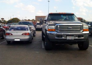 big-car-and-small-car-parked-photo246