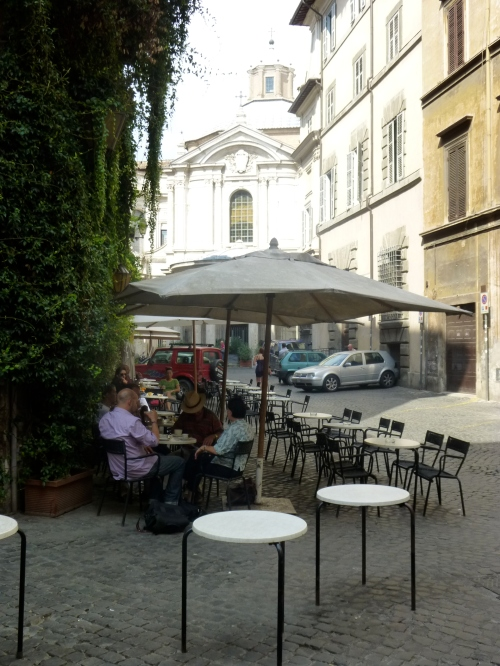 Shared use Roman street - pedestrians, restaurant seating and cars