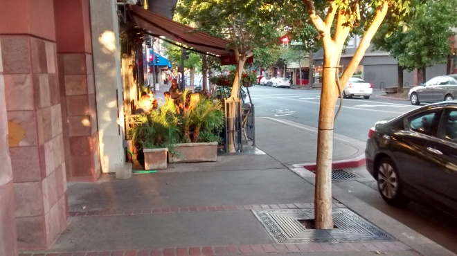 Outdoor seating in San Rafael, CA. Notice how the sidewalk swings out to occupy the parallel parking zone.